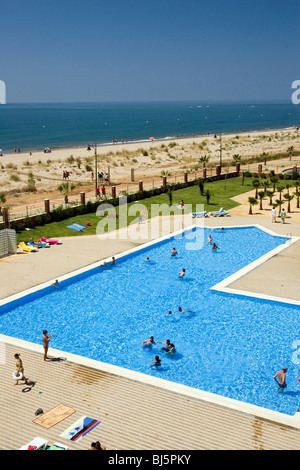 People in a swimming pool, Ayamonte, Spain - Stock Photo