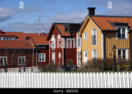 Traditional red and yellow Swedish houses in Mariefred, Sweden. - Stock Photo