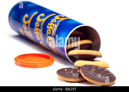 Jaffa cakes spilling from a tube - Stock Photo