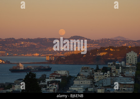 Full moon rising over San Francisco Bay - Stock Photo