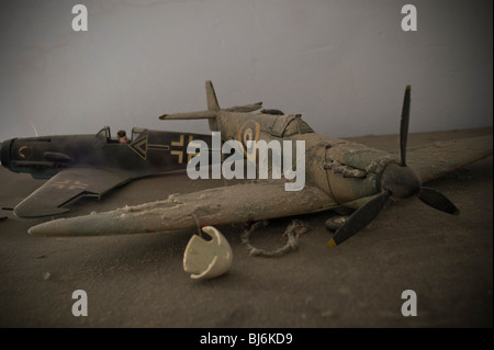 Scale models of a Spitfire and Messerschmidt 109 covered in dust and forgotten - Stock Photo