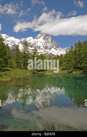 Il Lago Blu or the Blue Lake in Valtournenche Italy with the peak of the Matterhorn or Il Cervino in the background - Stock Photo