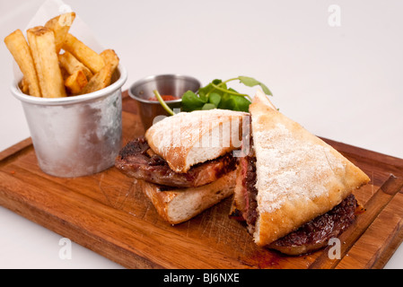 steak sandwich with chips - Stock Photo