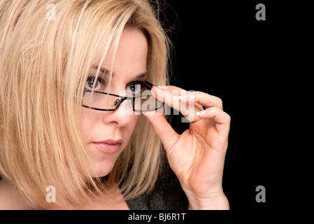 blonde woman wearing glasses - Stock Photo