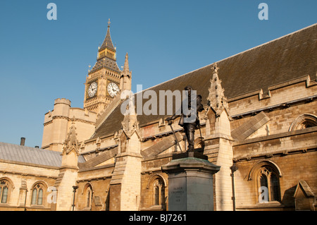 Statue of Oliver Cromwell, Houses of Parliament, Westminster, London, UK - Stock Photo
