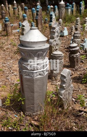 Indonesia, Sulawesi, Sidereng muslim cemetery, unusual pillar shaped gravestones - Stock Photo