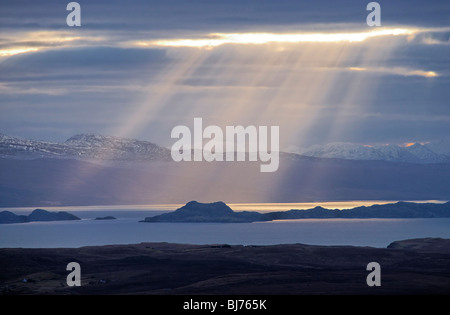 Sunbeam over the Isle of Raasay and The Minch. Seen from Trotternish, Isle of Skye, Scotland, UK. - Stock Photo