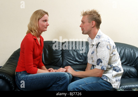 Couple having a talk on the couch at home - SerieCVS500202167 - Stock Photo