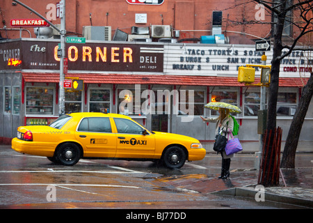 Woman hailing a taxicab in Soho, New York City - Stock Photo