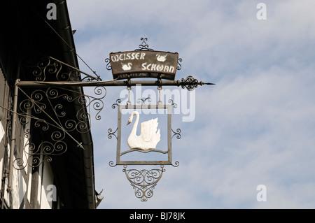 Restaurantschild WEISSER SCHWAN, Goslar, Deutschland. - Restaurant sign WHITE SWAN, Goslar, Germany. - Stock Photo