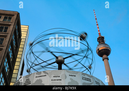 Urania-World Time Clock in front of Fernsehturm tower on Alexanderplatz, Berlin, Germany, Europe - Stock Photo