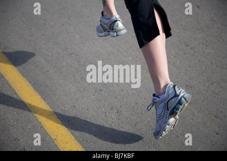 Close-up of a runner's feet and legs - Stock Photo