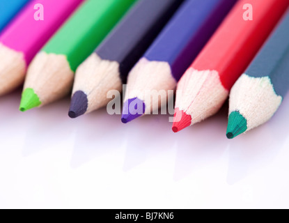 Macro of color pencils isolated on white background - Stock Photo