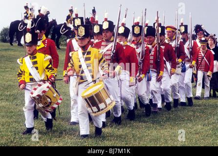British Infantry Redcoats marching in column, 1815 foot regiment regiments English British soldier soldiers uniform - Stock Photo