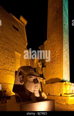 Pylon, obelisk and head of Ramses II, Luxor Temple, Egypt - Stock Photo