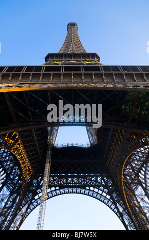 The Eiffel Tower seen from below / underneath, at dusk. Paris. France. - Stock Photo