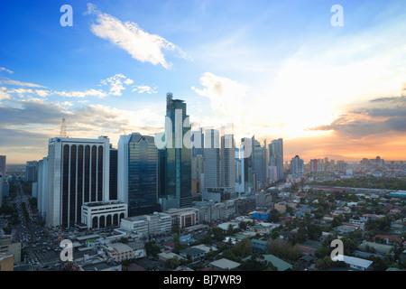 Sunset over business district Makati; Manila; Philippines - Stock Photo