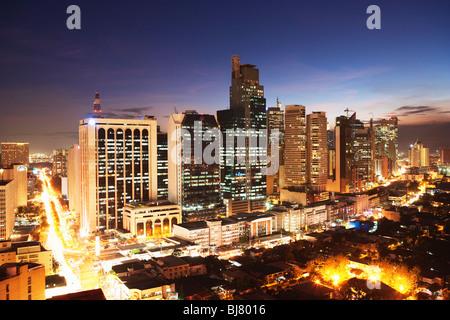 Night shot of business district Makati; Manila; Philippines - Stock Photo