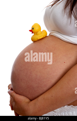 yellow rubber duck on belly of a pregnant woman Stock Photo ...