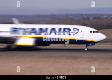Ryanair plane Boeing 737 taking off motion blur - Stock Photo