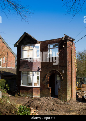 Cheshire, Mottram St Andrew, 1930 detached house being demolished to redevelop the site - Stock Photo