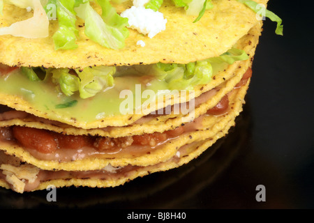 mexican tostadas meal or delicious snack,made with beef, corn tortilla, cilantro and onions on a fancy black mexican - Stock Photo