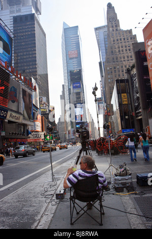 Man with a camera on Times Square, New York City, USA - Stock Photo