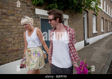 Couple walking home from flower market in summer, london, england, uk, europe - Stock Photo
