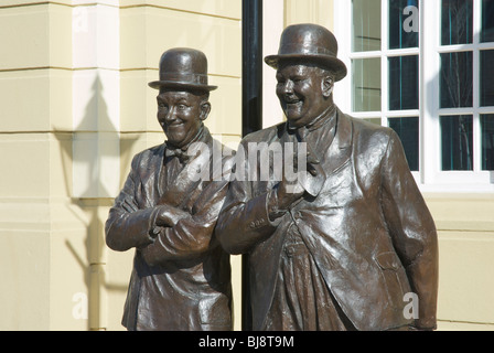 Statue of Stan Laurel and Oliver Hardy, outside Coronation Hall, Ulverston, Cumbria, England UK - Stock Photo
