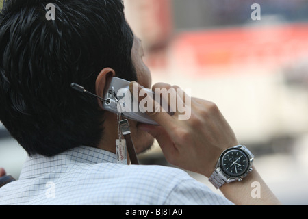 Japanese mobile telephone use by commuters and public in Tokyo, Japan, in 2007. - Stock Photo