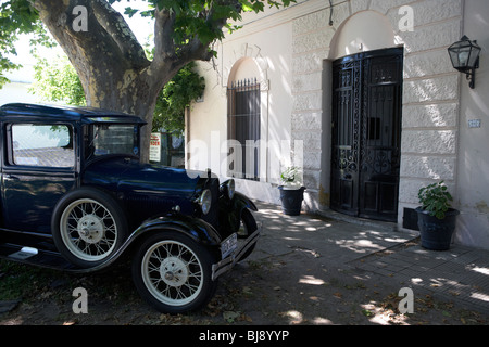 old vintage car outside the portuguese museum in Barrio Historico Colonia Del Sacramento Uruguay South America - Stock Photo