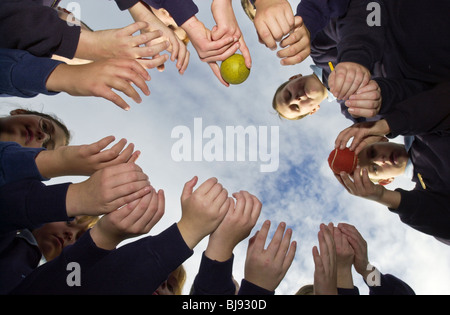 'cat & mouse' traditional playground ball game being played on the schoolyard of a primary school in Wales UK - Stock Photo