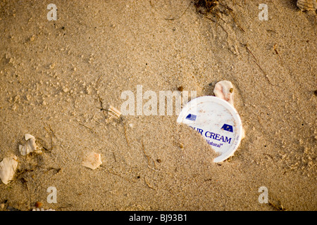 Garbage in the sand on the beach. - Stock Photo