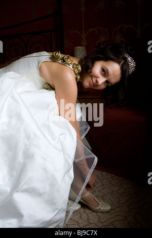 bride to be getting dressed and ready for her wedding - Stock Photo