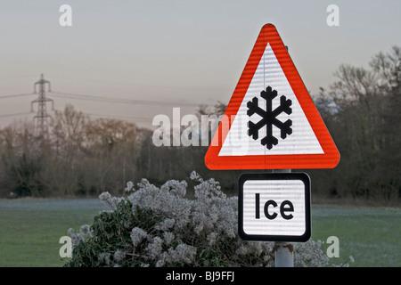 Road warning sign illuminated on a frosty morning - Stock Photo