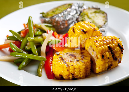 Meal of corn on the grill and baked potatoes - Stock Photo