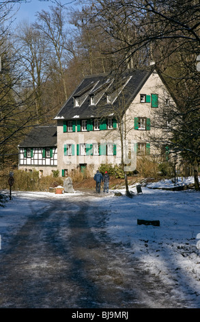 Winter scene showing the Winkelsmühle (mill) in Neanderthal near Düsseldorf, Germany. - Stock Photo