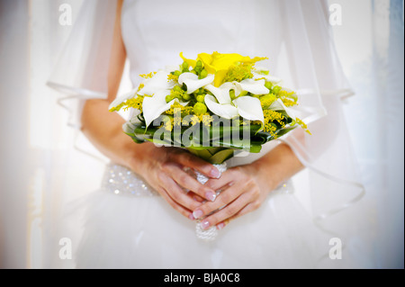 Bride holding the wedding bouquet - Stock Photo
