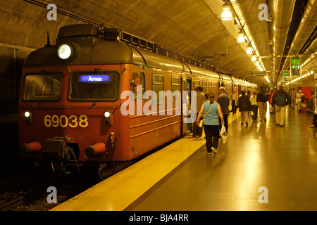 Commuter rail station in Oslo, Norway. Downtown portion is underground, outlying portions are above ground. - Stock Photo