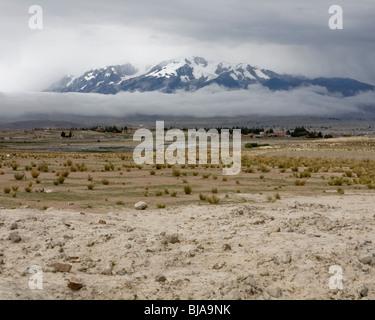 Mountain wrapped in fog, mount Ancohuma, Bolivia - Stock Photo