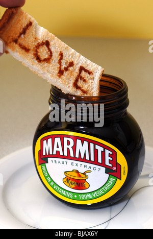 Generic image of Marmite with Love and Hate written on toast.  A Unilever Brand guaranteed to cause arguments - Stock Photo