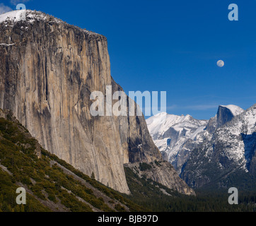 Yosemite Valley from Tunnel View with El Capitan and Half Dome with moonrise over snow covered peaks Yosemite National - Stock Photo