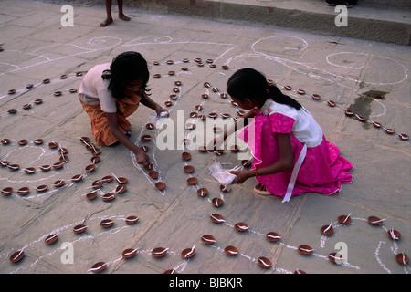 india, varanasi, kartik purnima festival, children preparing candles - Stock Photo