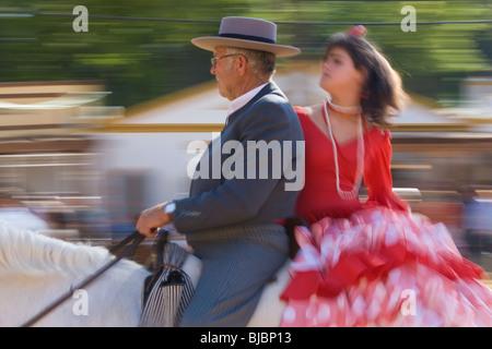 Horseman & lady in traditional dress, Jerez Horse Fair, Jerez De La Frontera, Andalucia, Spain - Stock Photo