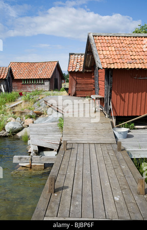 Traditional red painted fisherman's huts on the island of Svartloga in the 'Archipelago of Stockholm', Sweden. - Stock Photo
