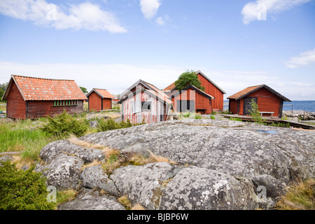 Traditional red painted fisherman's huts on the island of Svartloga'in the 'Archipelago of Stockholm' Sweden. - Stock Photo