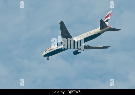 British Airways Plane descending towards Heathrow aiport. - Stock Photo