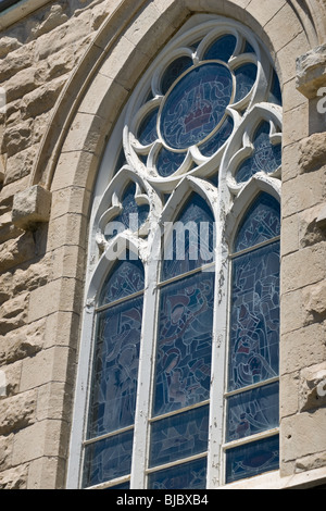 A closeup of a large stained glass window, taken at the 'Church of our lady', in Guelph, Ontario, Canada - Stock Photo