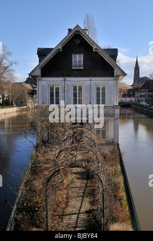 a house sits nestled between a fork in the river Ill - Stock Photo
