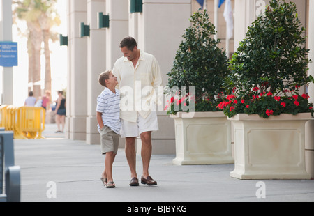 Caucasian father and son walking together - Stock Photo